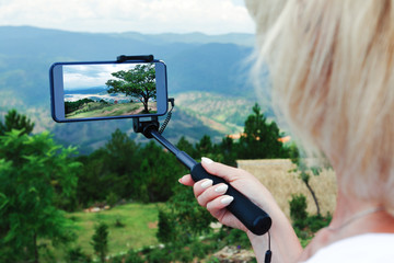 Image of female tourist photographing mountain, Travel holiday trip concept.