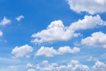 Blue sky with white clouds, rain clouds on sunny summer or spring day for background design.