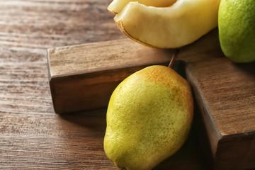 Delicious ripe pear on table, closeup