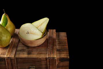 Delicious ripe pears on wooden crate