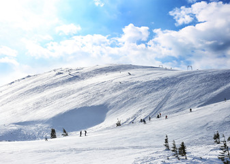 Ski slope at snowy resort on winter day