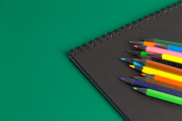 Note book and colored pencils