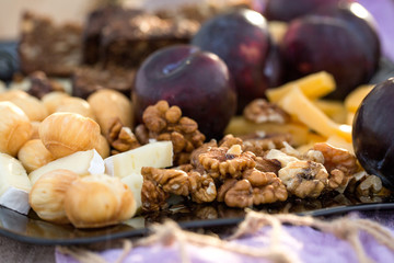 Snack to wine: walnuts, plums and cheese. For a romantic evening. For the wedding table. For a party of girls.