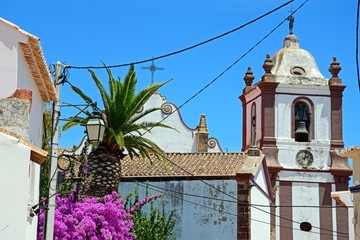 View of the Gothic cathedral (Igreja da Misericordia) with power cables in the foreground, Silves, Portugal.