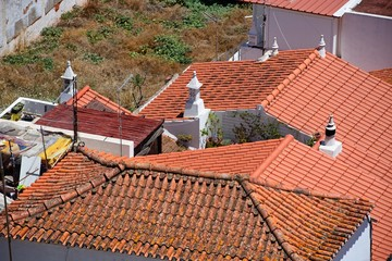 Elevated view of traditional Portuguese building rooftops seen from the castle, Silves, Portual.