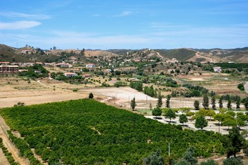 Elevated view of orchards and countryside seen from the castle battlements, Silves, Portugal.