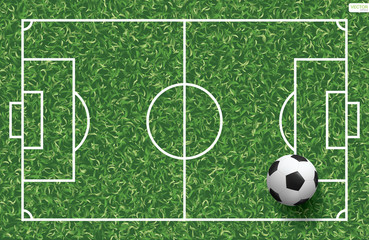 Soccer football ball on green grass of soccer field background. Vector.
