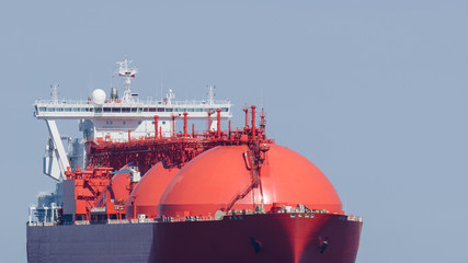 LNG TANKER - A big red ship on the sea