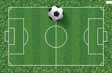Soccer football ball on green grass of soccer field background. Vector.