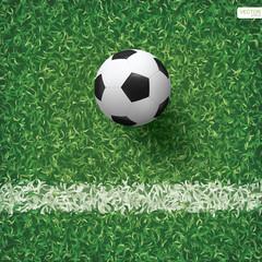 Soccer football ball on green grass of soccer field background. Vector illustration.