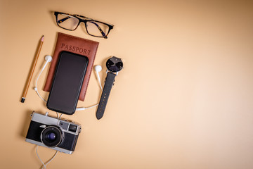 Luxury Travel accessories on brown copy space