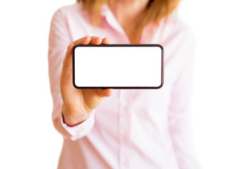 Woman showing phone with horizontal empty white screen. Mobile app mockup.