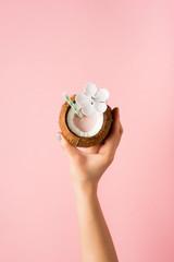 Refreshing summer drinks. Coconut drink on pastel pink background. Trendy summer color.