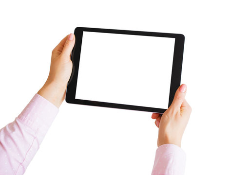 Woman holding tablet in hands with empty white screen.