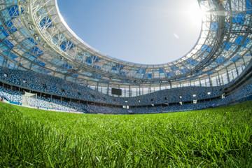 Sport grass field stadium on a sunny day blue sky.