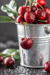 Fresh cherry with water drops on dark stone background. Fresh cherries background. Healthy food concept