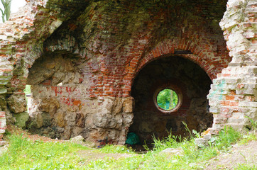 Round hole looks like a portal to another dimension on a brick wall in ancient ruins
