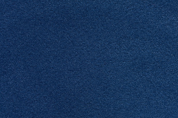 Soft fabric texture in saturated dark blue colour.