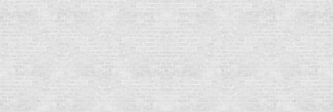 Vintage white wash brick wall texture for design. Panoramic background