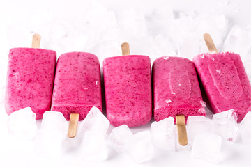 Refreshing Homemade Berry Popsicle with Ice Cube Healthy Diet Summer Dessert White Background Tasty Ice Cream