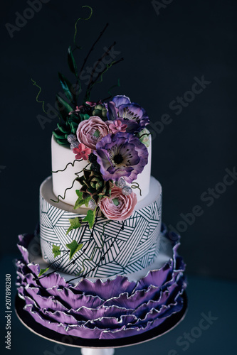 White wedding cake with purple flower detailpurple wedding cake white wedding cake with purple flower detailpurple wedding cake decorated with flowers and pearlsree layers cake with sugar paste flowers stock photo mightylinksfo