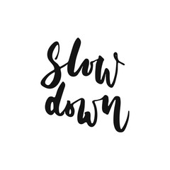 Slow down - hand drawn motivation lettering phrase isolated on the white background. Fun brush ink vector illustration for banners, greeting card, poster design.