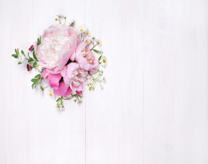Bouquet of beautiful flowers on white wooden background. Top view. Copy space