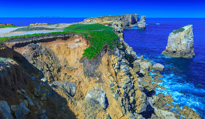 Foto op Canvas Blauw Wonderful romantic afternoon panoramic seascape. Coastline cliffs of the Atlantic ocean in Peniche. West coast of Portugal at sunny weather.