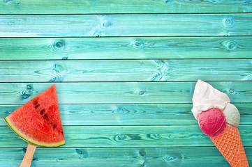 Watermelon popsicle and ice cream cone on blue planks background with copy space, summer concept