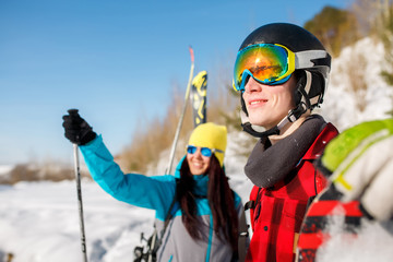 Image of sports man and woman pointing forward walking on snow hill