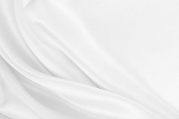 Smooth elegant white silk or satin luxury cloth texture as wedding background. Luxurious Christmas background or New Year background design