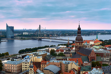 Riga, Latvia: sunset aerial view of Old Town and Daugava River. The tower of Dome Cathedral, a symbol of the city.