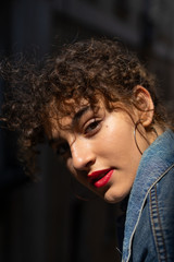 Pretty curly girl with red lips