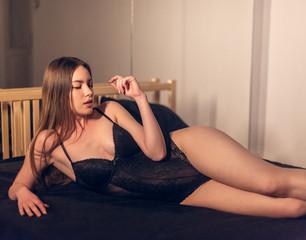 Seductive woman in black bodysuit