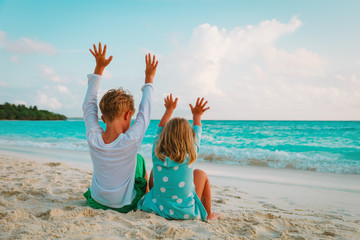happy kids-little boy and girl- have fun on beach