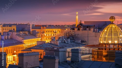 Fotobehang Beautiful sunset over rooftops of St Petersburg, Russia. Zoom in on city skyline .4K UHD timelapse.