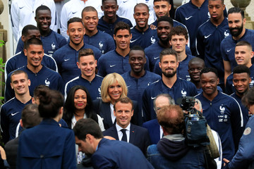 French President Emmanuel Macron and his wife Brigitte Macron pose France coach Didier Deschamps, and French soccer team at the French national football team training center in Clairefontaine near Paris