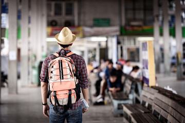 Bus station with young man are enjoying traveling.