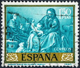 stamp printed by Spain, shows picture Sacred Family of the Bird by Murillo