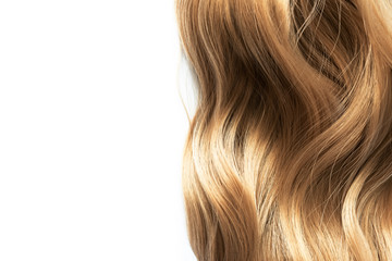 long blond wavy hair isolated on white background Wall mural