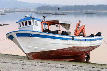 wooden fishing boat dries ashore