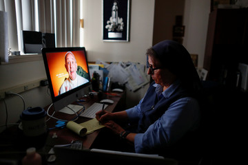 Sister Rose Pacatte, a Catholic nun who reviews movies,  is shown in her office in this picture taken May 24, 2018 in Culver City,