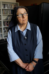 Sister Rose Pacatte, a Catholic nun who reviews movies, poses for a picture at her  office in this picture taken May 24, 2018 in Culver City, California