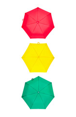 Red, yellow and green umbrellas in the form of a traffic lights isolated on white background
