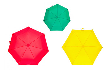 Multicolored umbrellas isolated on white background. Red, green and yellow umbrella