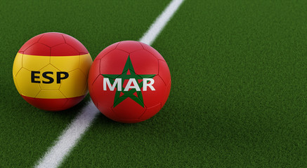 Spain vs. Morocco Soccer Match - Soccer balls in Spains and Moroccos national colors on a soccer field. Copy space on the right side - 3D Rendering