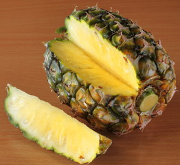 One whole sweet pineapple with green leaves