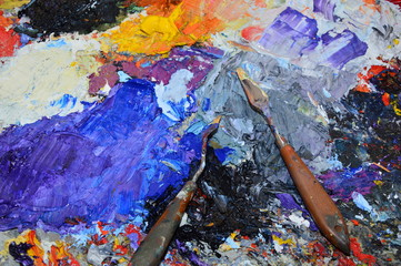 A painter's palette in his workshop with tools