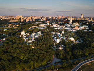 Aerial top view of Kiev Pechersk Lavra churches on hills from above, cityscape of Kyiv city