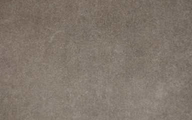 Gray concrete wall with small dash pattern and fine grain texture. Black and white photo of vintage background. Horizontal orientation